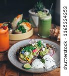 smashed avocado on toast with... | Shutterstock . vector #1165334353
