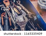 cose up of old toolbox. toolset ... | Shutterstock . vector #1165335409