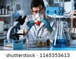 scientist working with a flask... | Shutterstock . vector #1165353613