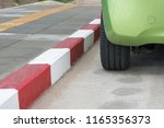 car stop near white and red... | Shutterstock . vector #1165356373