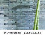 gray brick wall and bamboo ... | Shutterstock . vector #1165383166