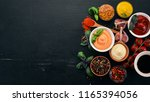 set the sauces on a black...   Shutterstock . vector #1165394056