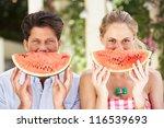 couple enjoying slices of water ... | Shutterstock . vector #116539693
