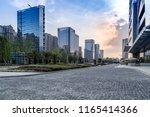 empty ground and skyscrapers ... | Shutterstock . vector #1165414366