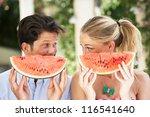 couple enjoying slices of water ... | Shutterstock . vector #116541640