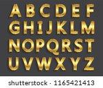 vector golden letters.set of... | Shutterstock .eps vector #1165421413