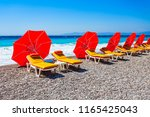 sunbeds with umbrellas at the...   Shutterstock . vector #1165425043