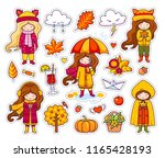 set of cute autumn girls.... | Shutterstock .eps vector #1165428193