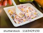 fast food. salad with a plastic ... | Shutterstock . vector #1165429150