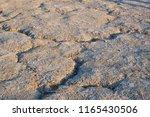 dry soil of the earth. cracks... | Shutterstock . vector #1165430506