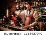bartender in the white shirt... | Shutterstock . vector #1165437040