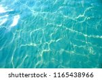 sea surface glares sunny sandy... | Shutterstock . vector #1165438966