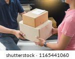 woman receiving parcel... | Shutterstock . vector #1165441060