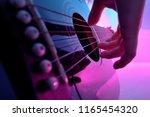 Closeup Of An Acoustic Guitar...