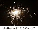 sparkler in summer   Shutterstock . vector #1165455139