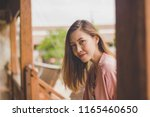 women are smiling and staring. | Shutterstock . vector #1165460650