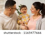 family  parenthood and people... | Shutterstock . vector #1165477666