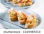 bruschetta from norwegian... | Shutterstock . vector #1165485313