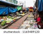 maeklong railway market ... | Shutterstock . vector #1165489120
