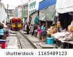 maeklong railway market ... | Shutterstock . vector #1165489123