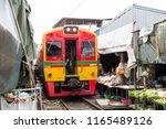 maeklong railway market ... | Shutterstock . vector #1165489126