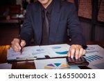 asian businessman or accountant ... | Shutterstock . vector #1165500013