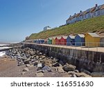 A Line Of Colourful Beach Huts...