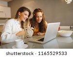 two young women online via a... | Shutterstock . vector #1165529533