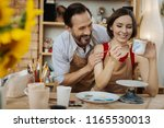 laughing ceramists. couple of... | Shutterstock . vector #1165530013