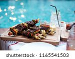 barbecue party near pool | Shutterstock . vector #1165541503