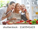 healthy food at home. happy... | Shutterstock . vector #1165541623