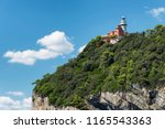lighthouse on tino island ... | Shutterstock . vector #1165543363