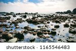 Stunning wide view of rocky tidepools in front of cloudy sea
