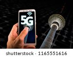 smartphone with 5g on screen... | Shutterstock . vector #1165551616
