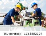 two engineers working inside...   Shutterstock . vector #1165552129