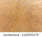 empty beach with no people... | Shutterstock . vector #1165553179