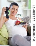 Young pregnancy holding fresh fruits, concept - healthy food - stock photo