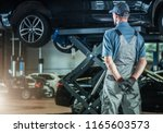 Auto Service Business. Caucasian Supervisor in His 30s Inside Vehicles Repair Center. Automotive Industry Theme. - stock photo