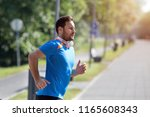 satisfied handsome man running...   Shutterstock . vector #1165608343