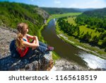 woman hiker sits on the rock... | Shutterstock . vector #1165618519