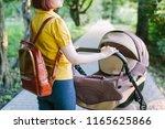 walking mother with baby... | Shutterstock . vector #1165625866