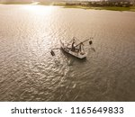 aerial view of shrimp boat off... | Shutterstock . vector #1165649833
