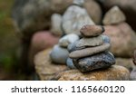 some stones stacked | Shutterstock . vector #1165660120