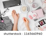 young woman freelancer working... | Shutterstock . vector #1165660960