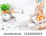 various kitchen utensils.... | Shutterstock . vector #1165665643