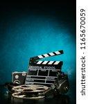 vintage film claper with film... | Shutterstock . vector #1165670059