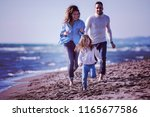 family with kids resting and... | Shutterstock . vector #1165677586