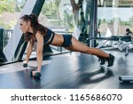 beautiful athlete female doing... | Shutterstock . vector #1165686070