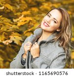 outdoors fashion portrait of...   Shutterstock . vector #1165690576