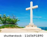 cross monument at adriatic sea... | Shutterstock . vector #1165691890